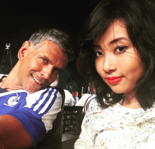 Milind Soman trolled for dating an 18 year old girl.