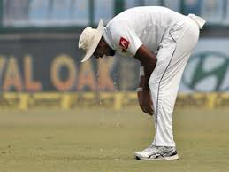 Lakmal vomits during match